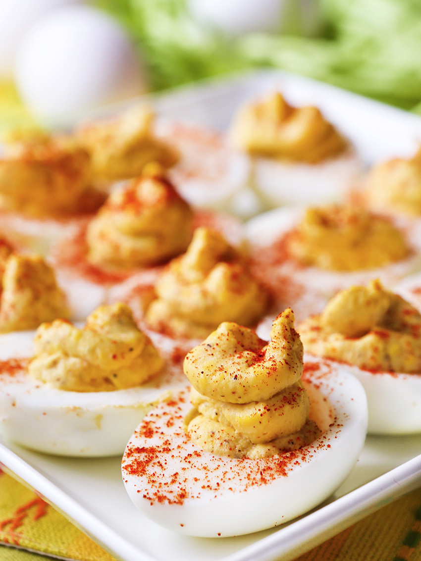 best deviled eggs ever, lined up on a serving plate