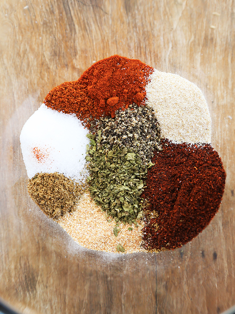 Spices for taco seasoning in mixing bowl