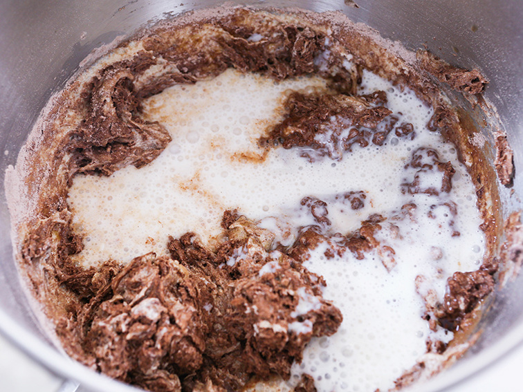 Batter and milk in a mixing bowl