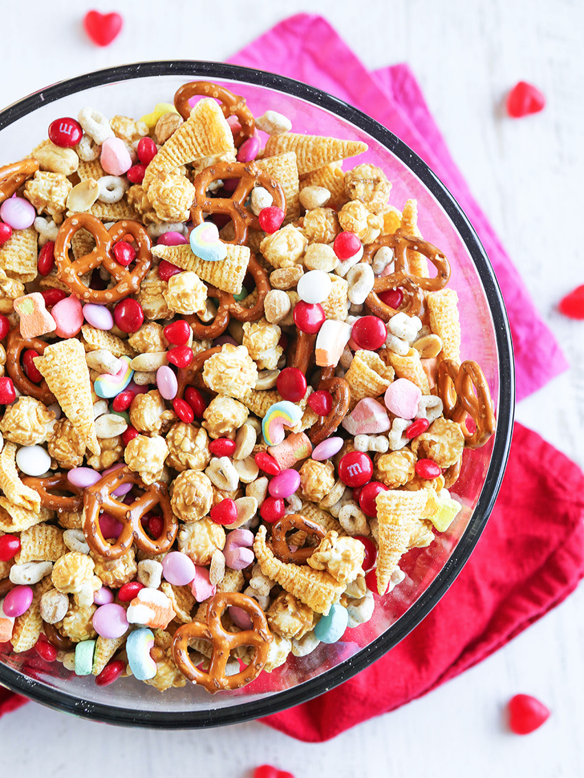 top view of large bowl of valentine snack mix