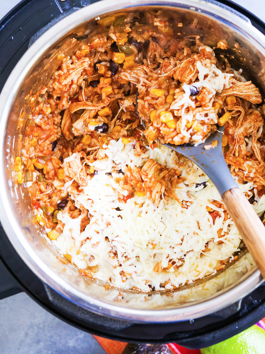 Top view of Instant Pot filled with chicken burrito bowl filling