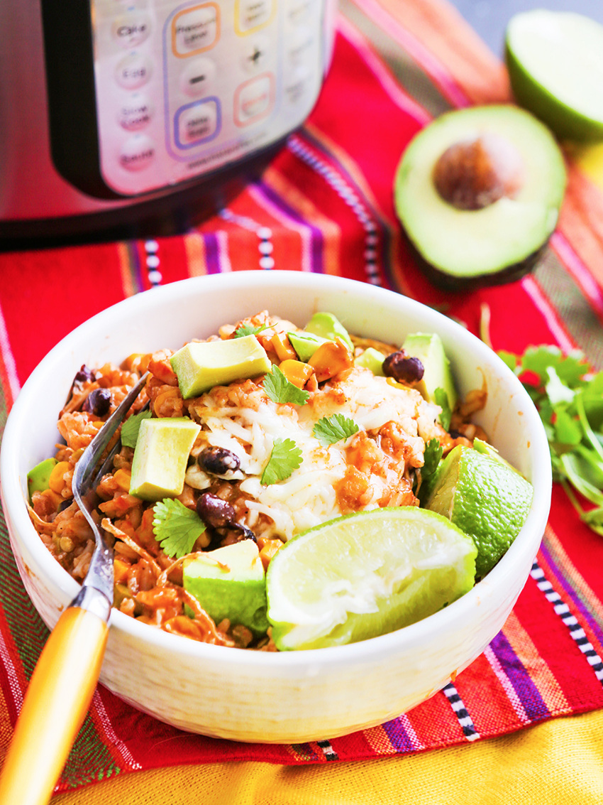 A chicken burrito bowl sitting next to Instant Pot