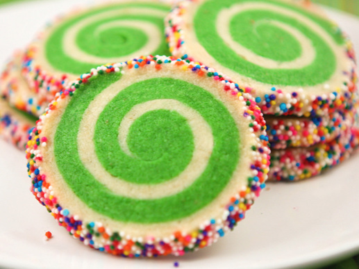 spiral cookies with sprinkles on a serving plate