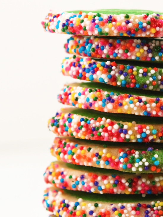 close up side view of baked sugar cookies with sprinkles on outsides