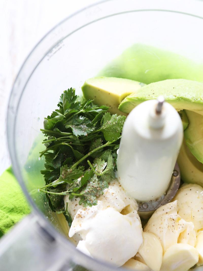 avocados and cilantro in a food processor