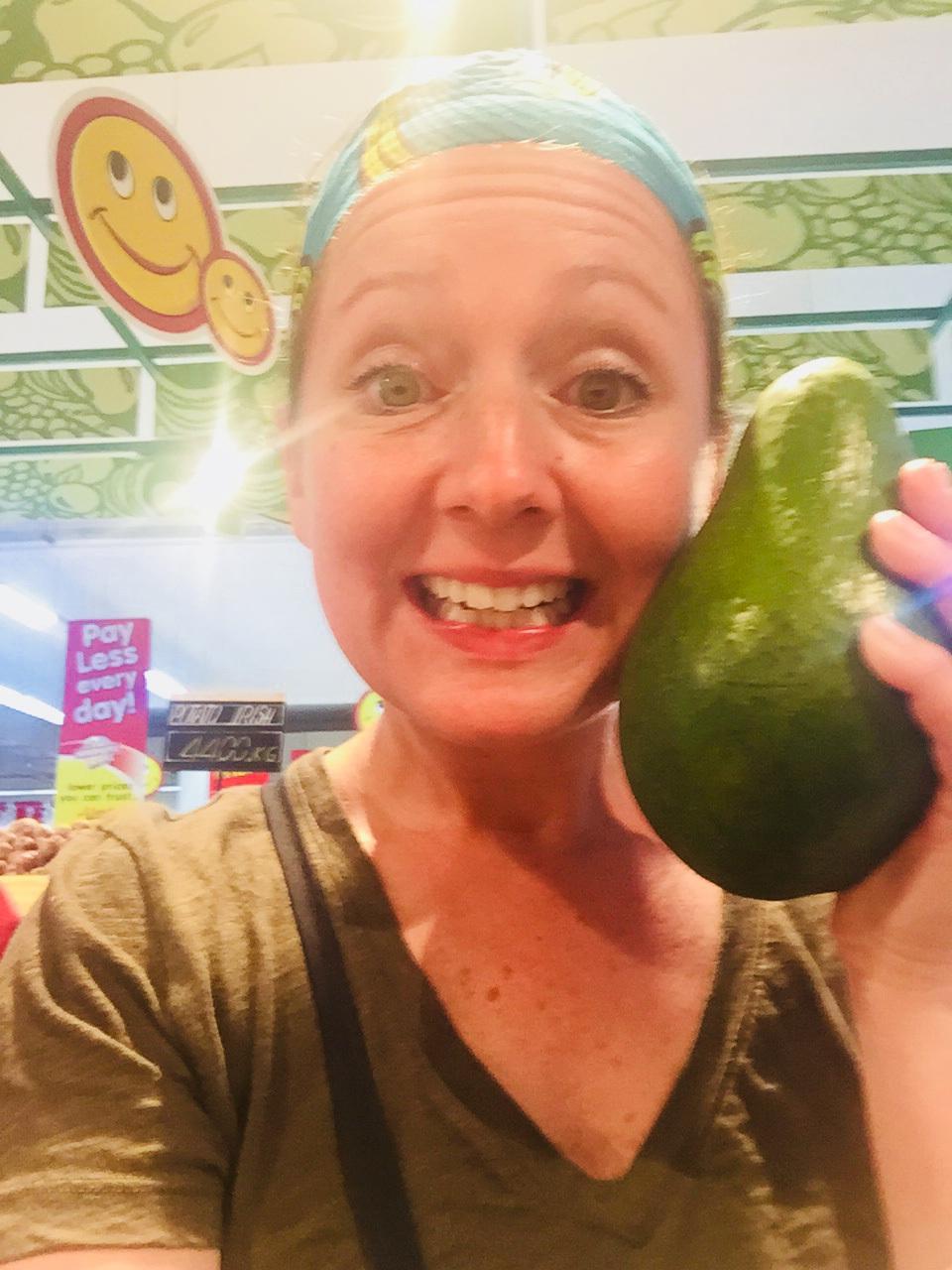 Me holding a giant avocado