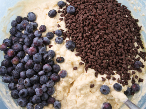 pancake batter in a mixing bowl with blueberries and chocolate chips