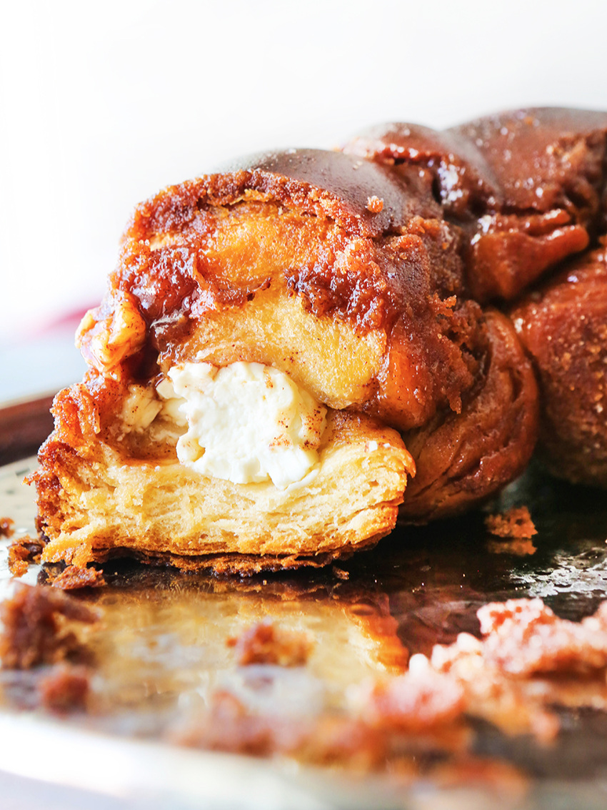 Center of a loaf of monkey bread exposed to find cream cheese