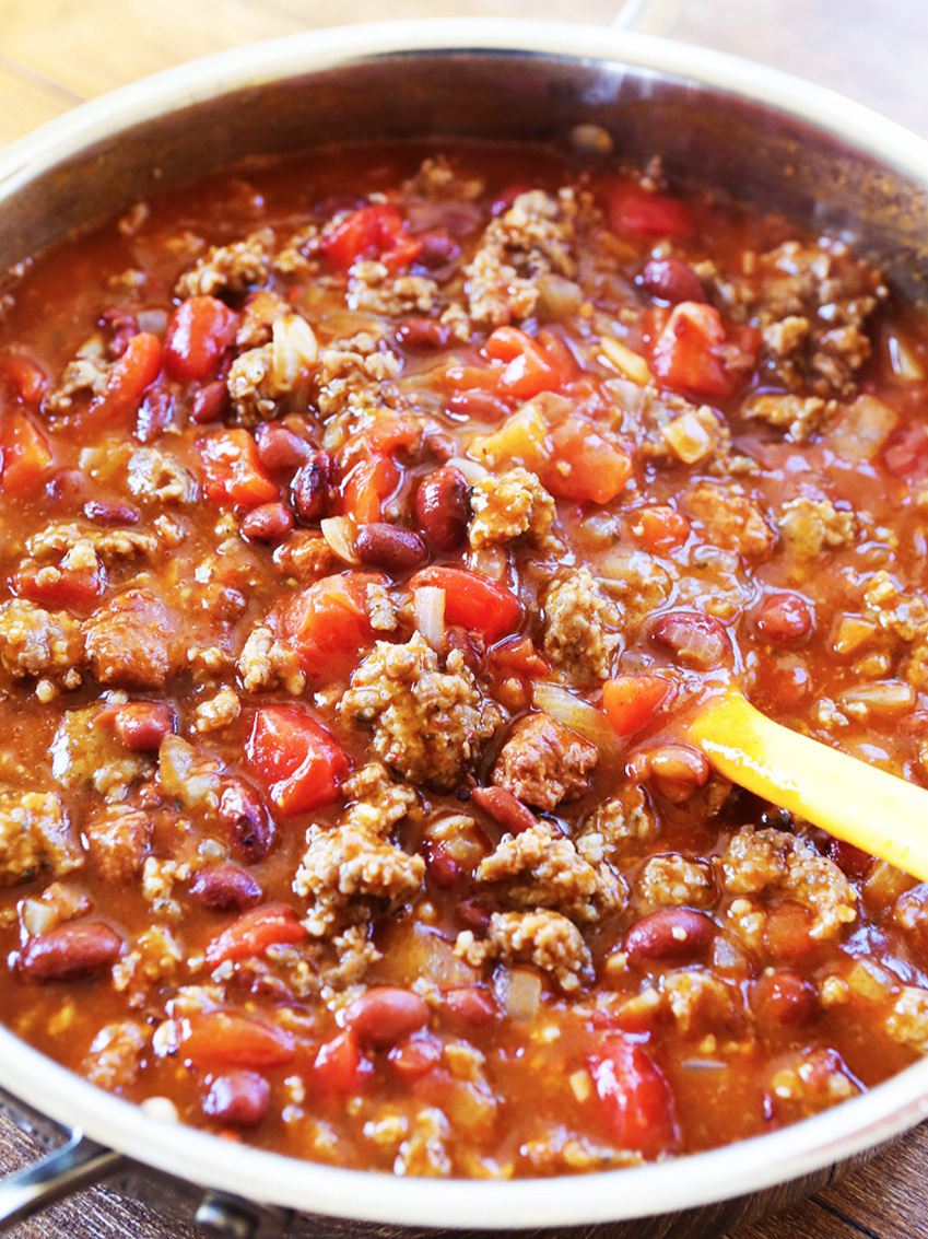 Skillet of 5 ingredient chili with serving spoon resting on edge