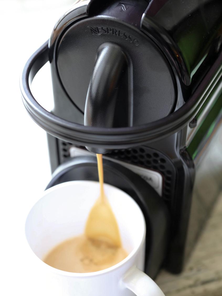Nespresso pouring coffee into a mug