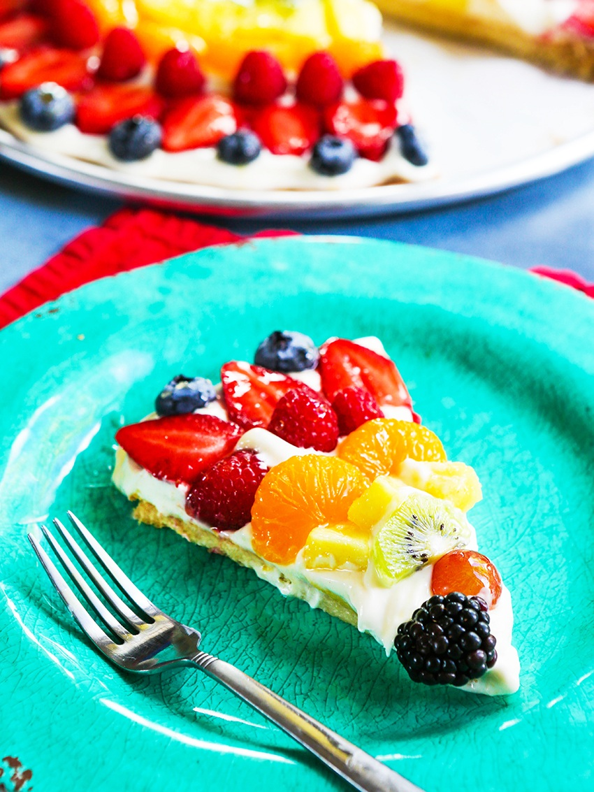 slice of colorful fruit pizza on an turquoise plate