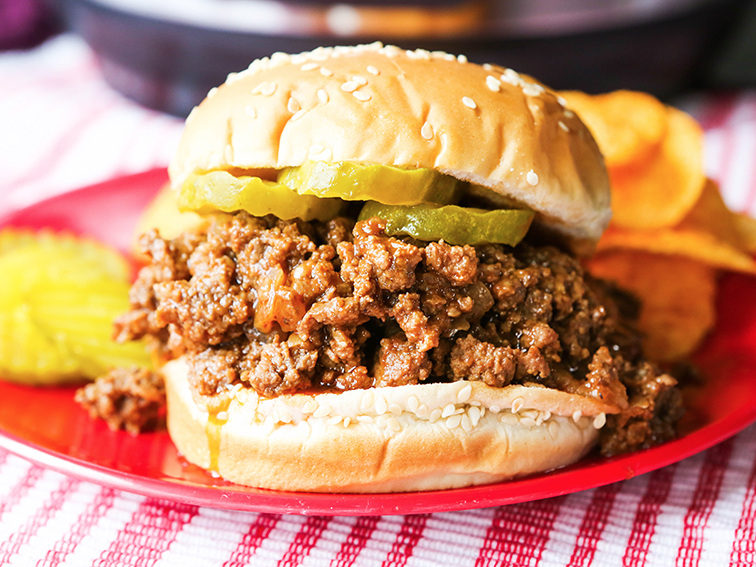 Sloppy joe sandwich on a plate next to Instant Pot