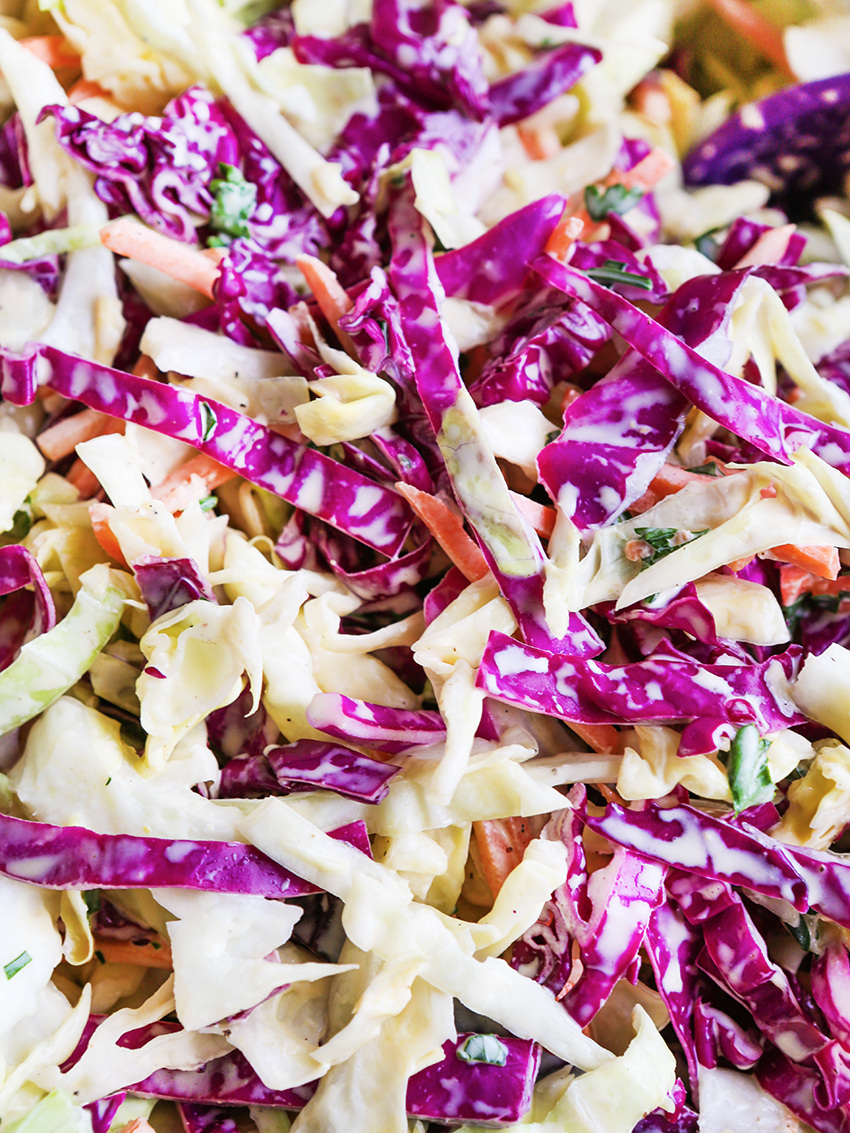 Close up of coleslaw with a focus on red cabbage