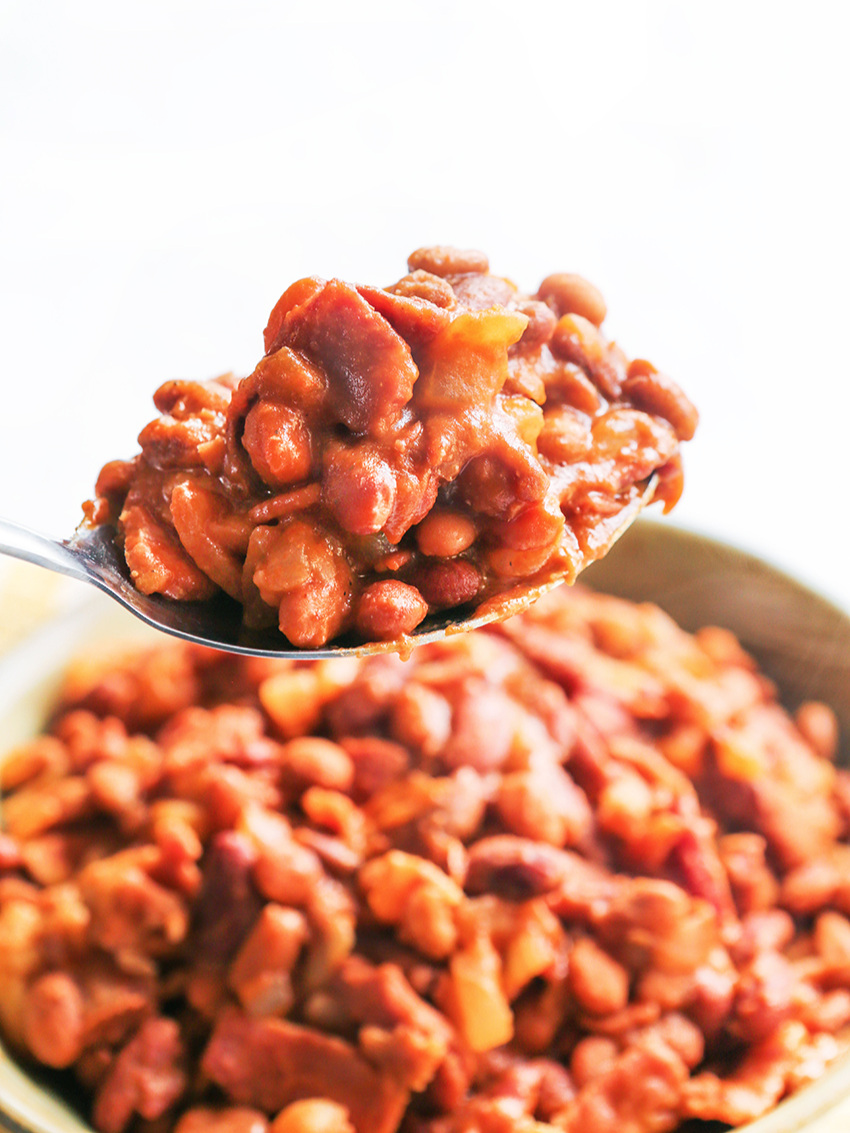 Spoonful of baked beans hovering over Instant Pot
