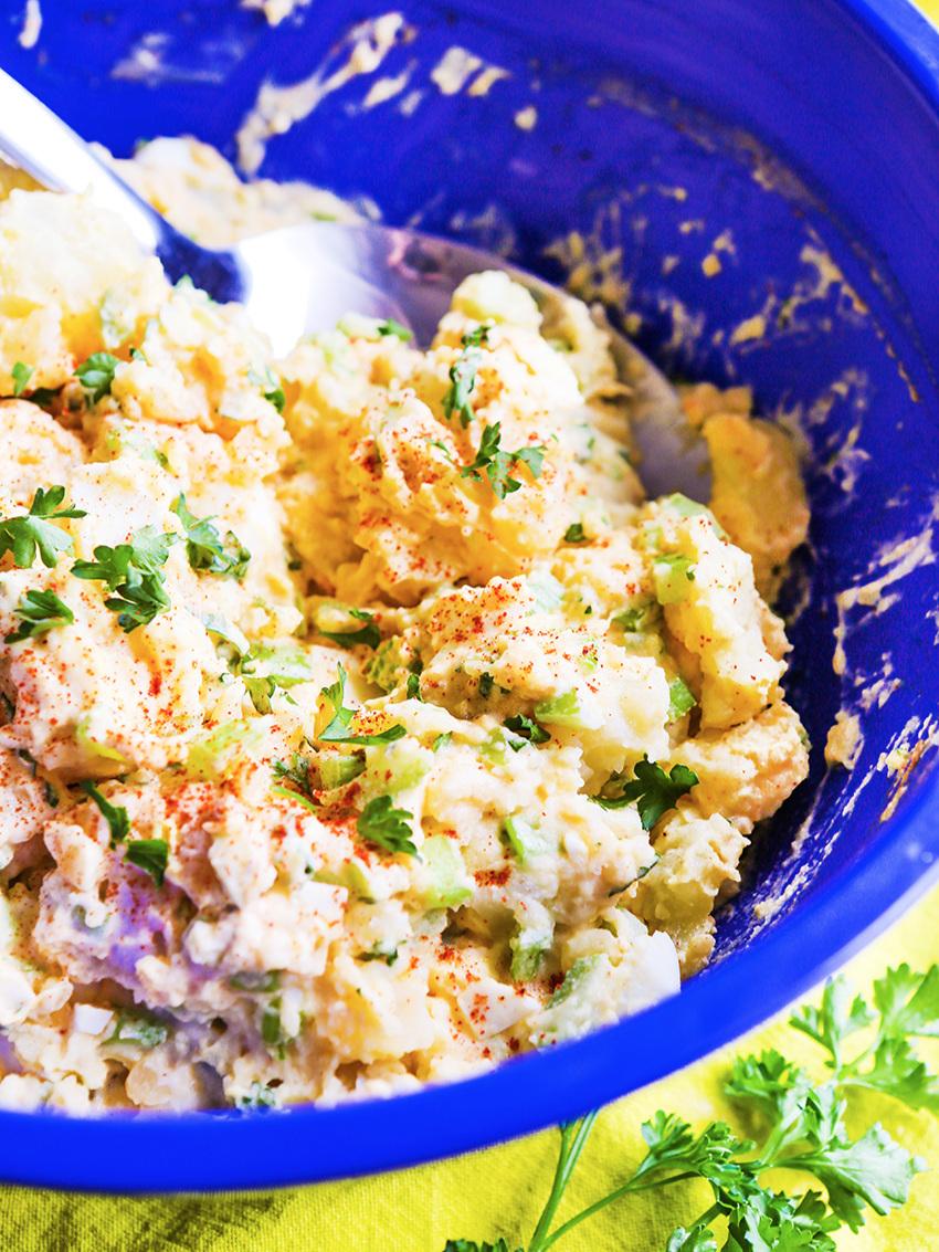 Close up of blue bowl full of potato salad