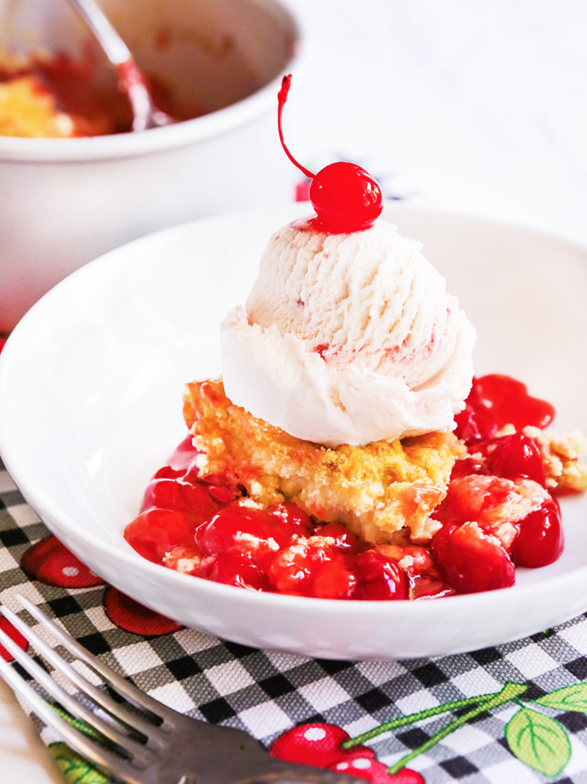 Cherry cake with ice cream and a cherry on top