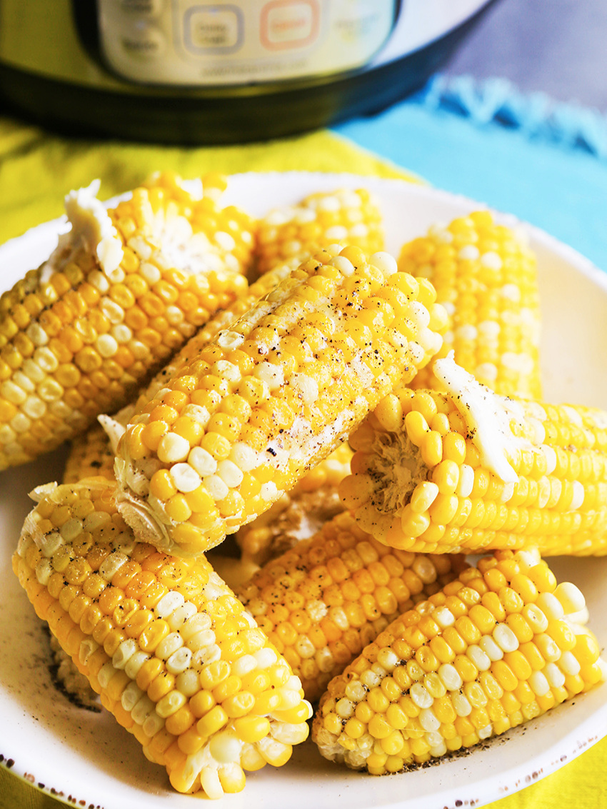 Instant Pot corn on a cob stacked on a plate