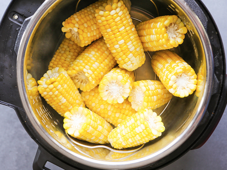Corn cobs piled inside of an Instant Pot