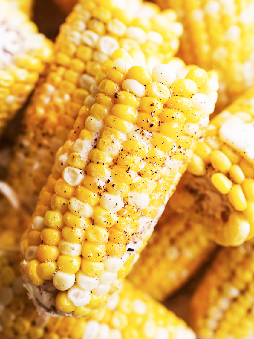 Close up of corn on the cob with butter and pepper
