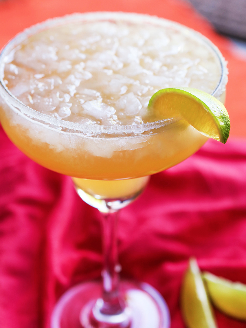 A margarita on the rocks with salt on the rim