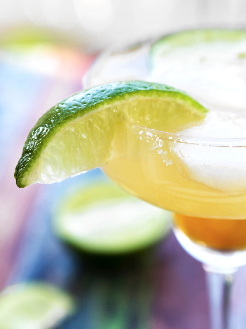Margarita in a glass with a lime wedge