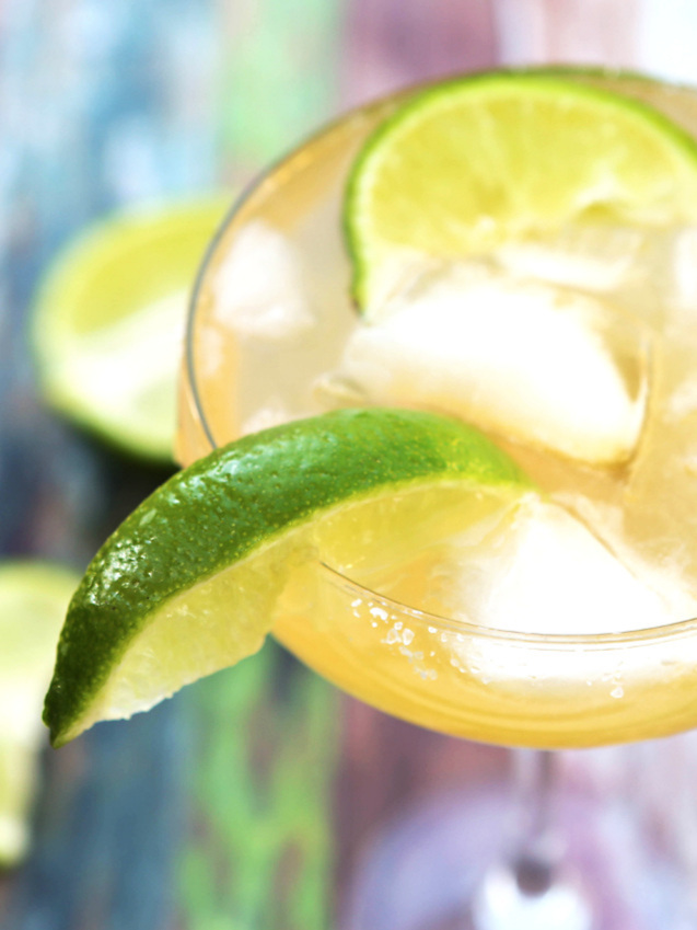Looking into margarita glass with lime wedge