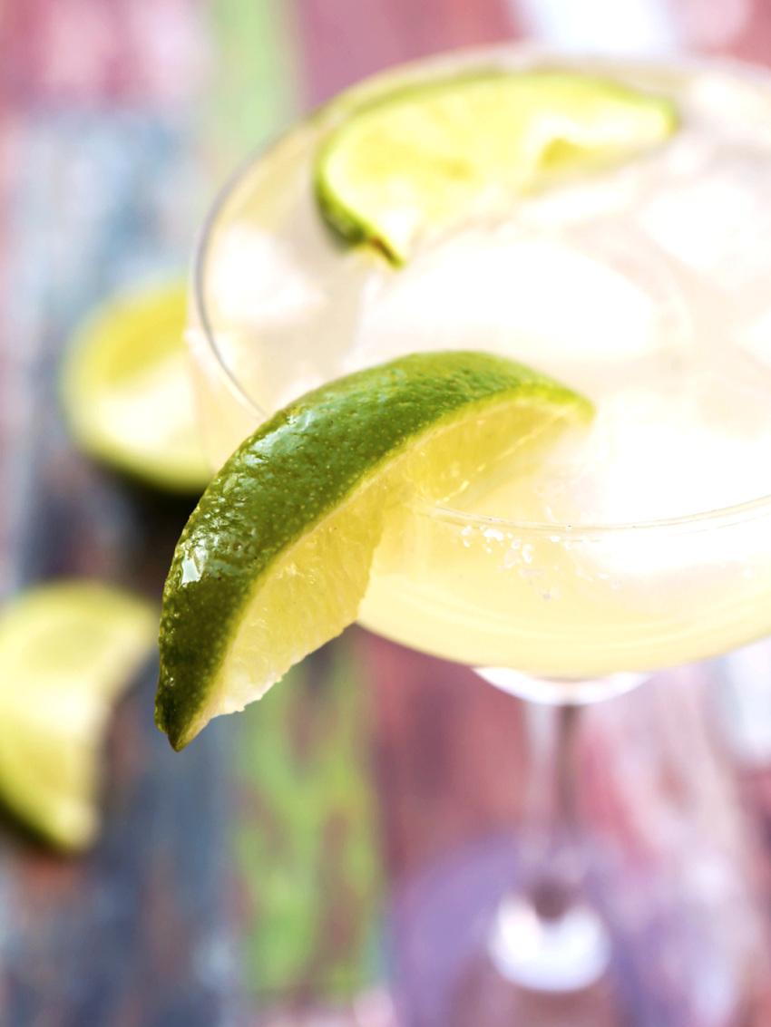 Margarita on the rocks with salt on the rim and a lime wedge