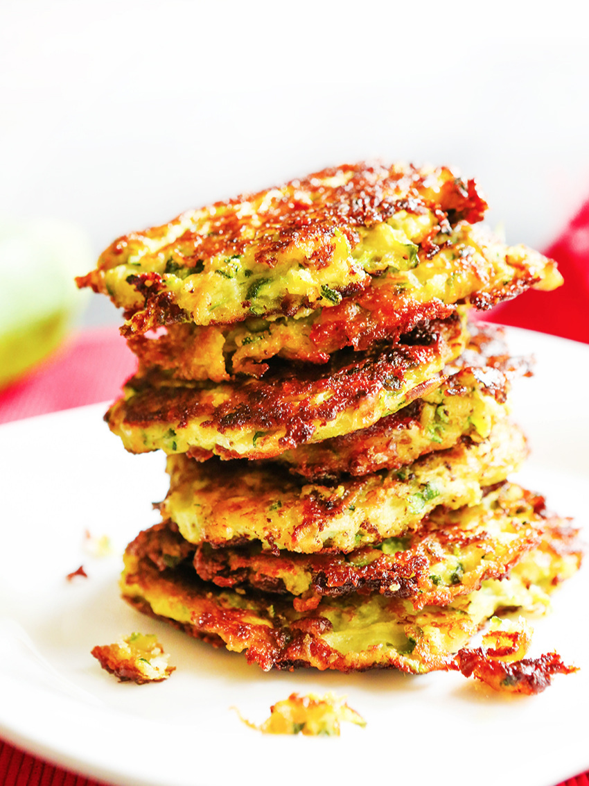 Stack of easy zucchini fritters on a plate.