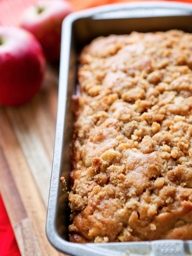 close up of a loaf of apple bread in a pan