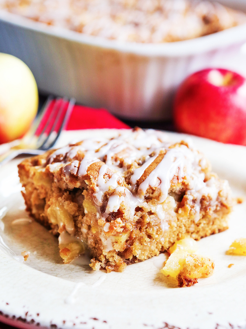 slice of apple coffee cake sitting next to pan