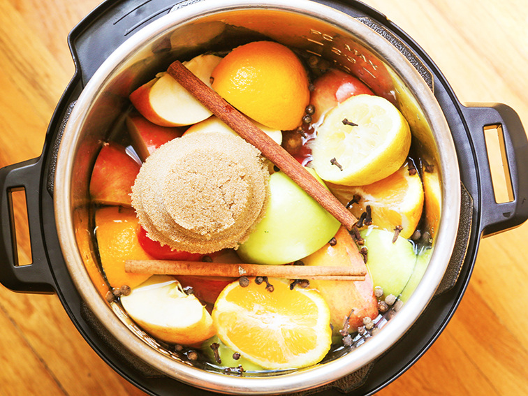 top view of the inside of the instant pot with all the ingredients ready to make instant pot apple cider