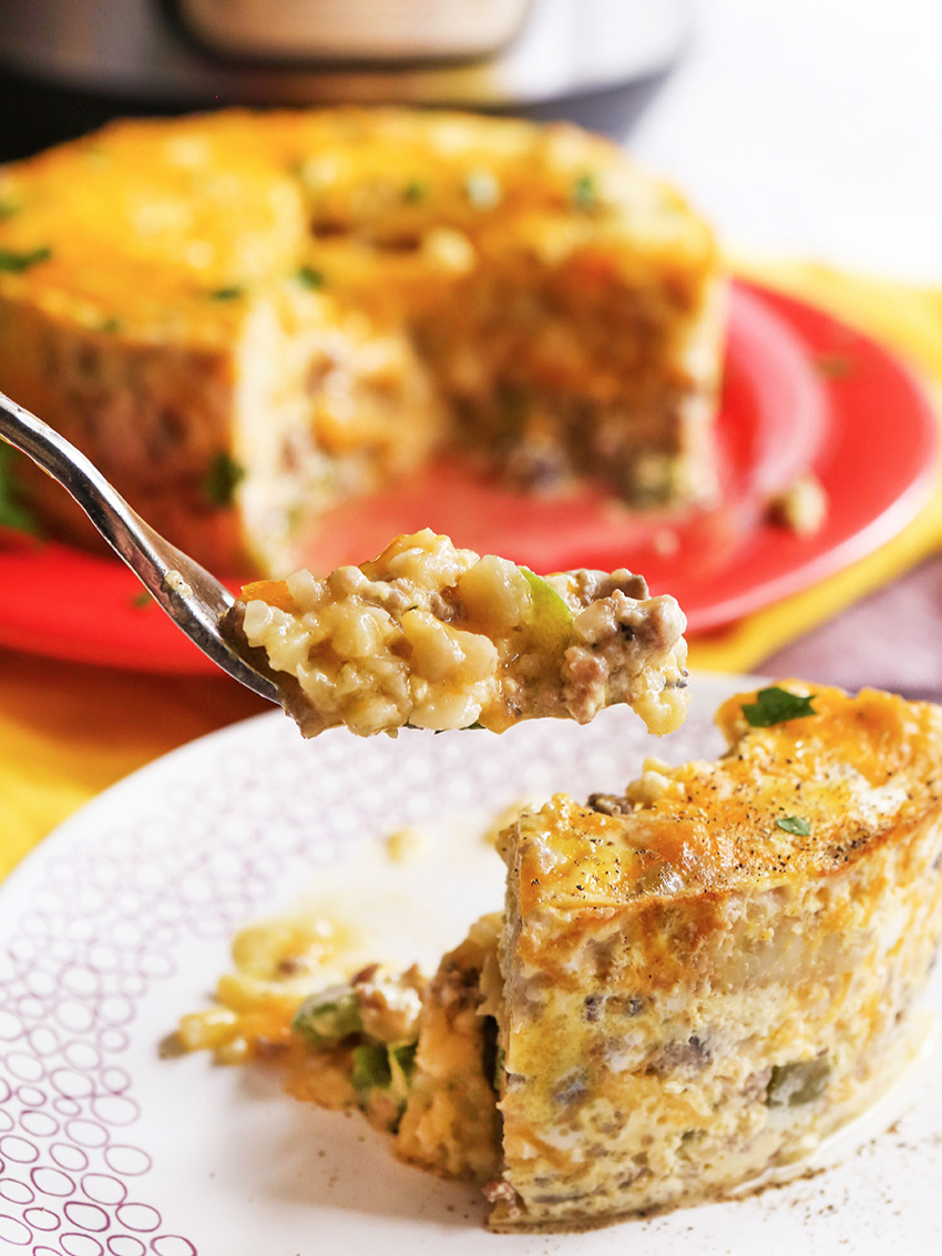 forkful of instant pot breakfast casserole over plate