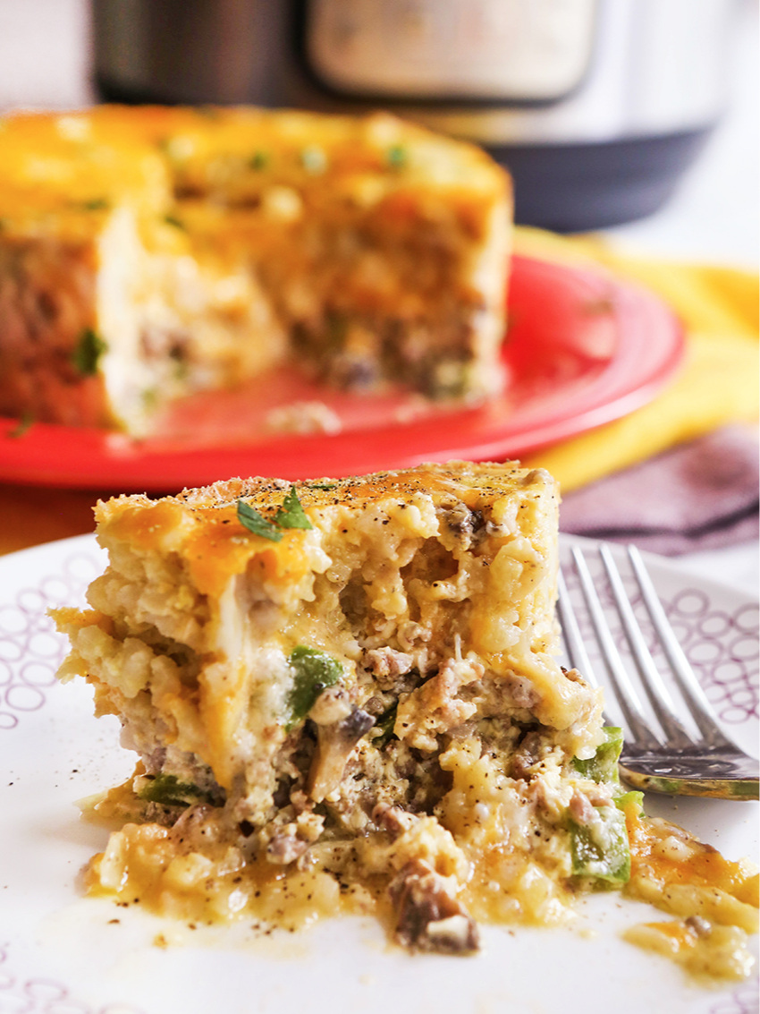 Breakfast casserole on a plate sitting next to an Instant Pot