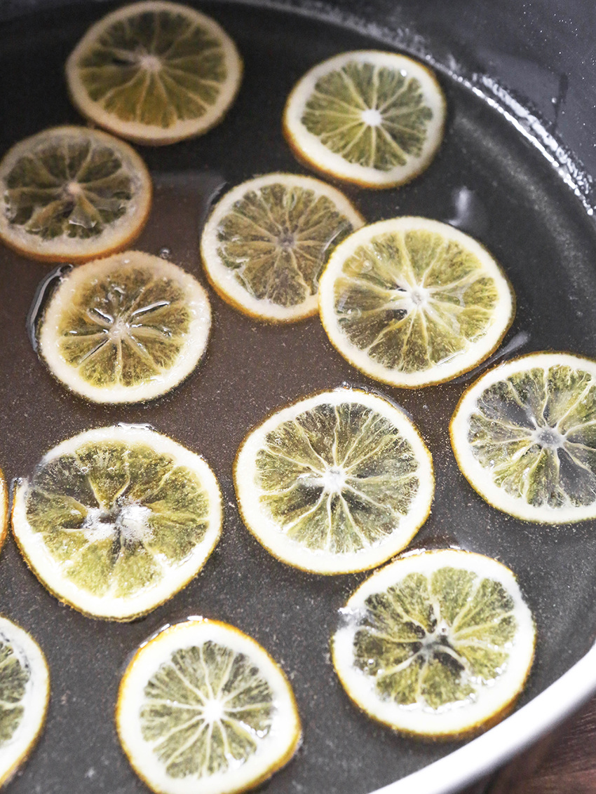 lemon slices cooking in liquid in a saucepan