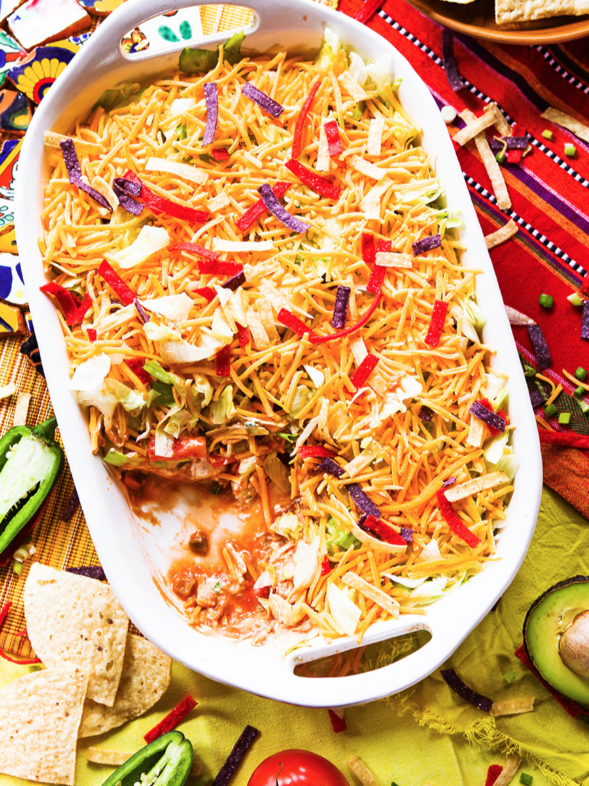 Top view of pan of 7 layer taco dip