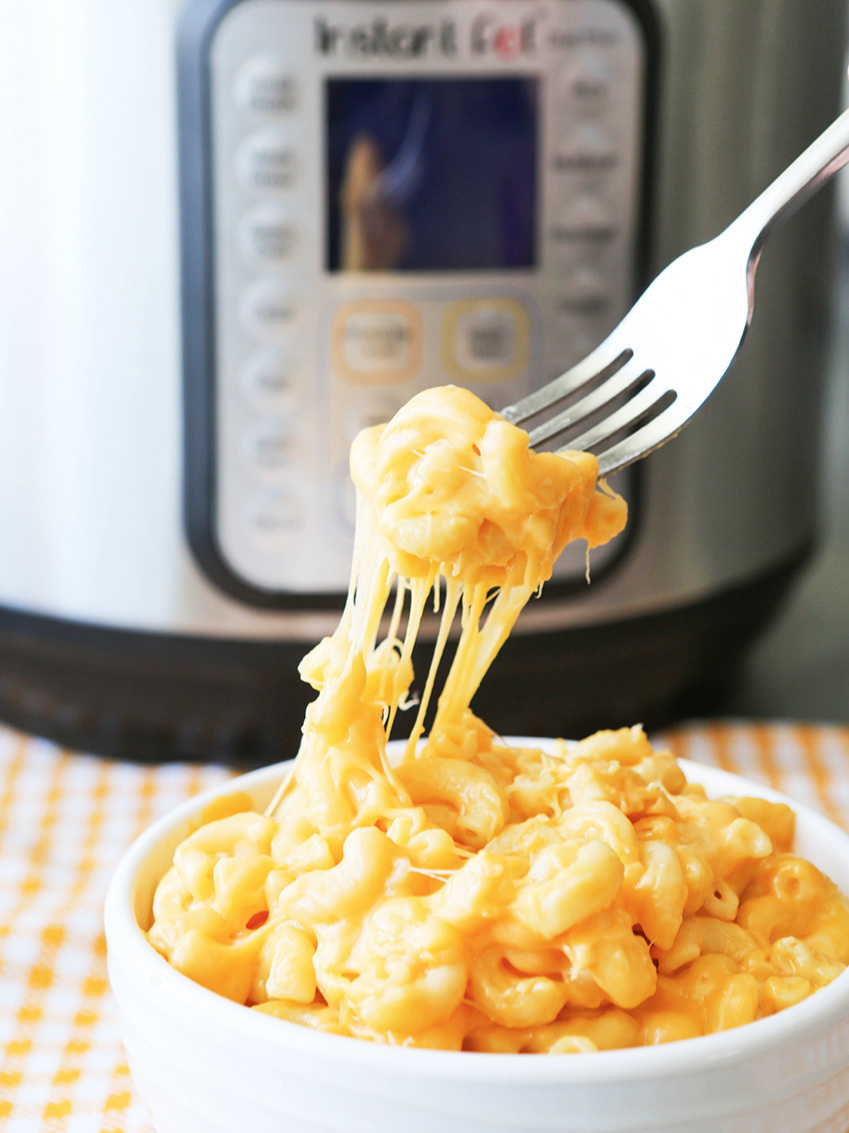 Fork pulling mac and cheese out of bowl