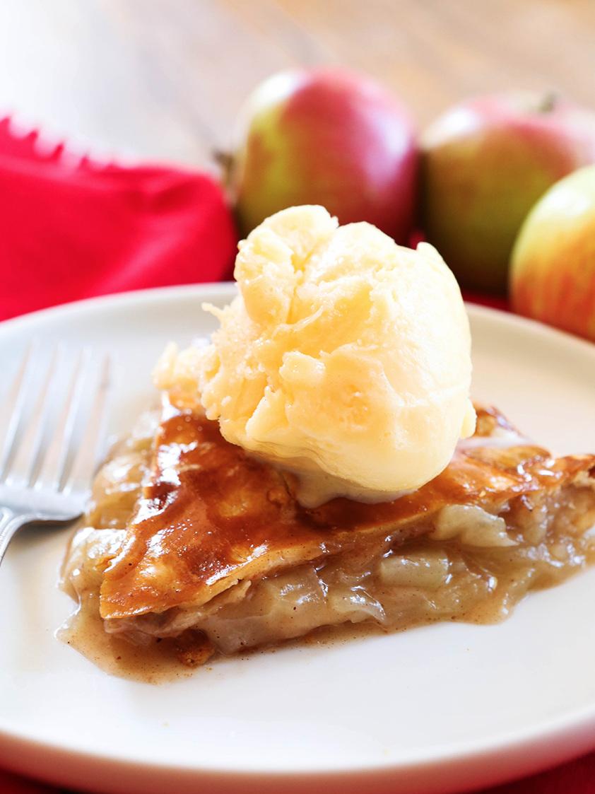 slice of easy apple pie with a scoop of vanilla ice cream on top