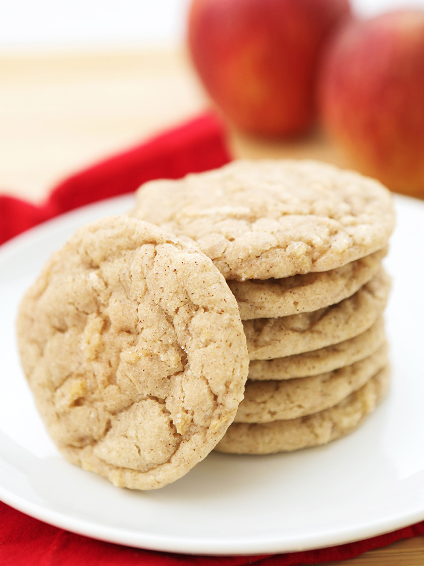 Stack of apple snickerdoodle cookies on a white plate