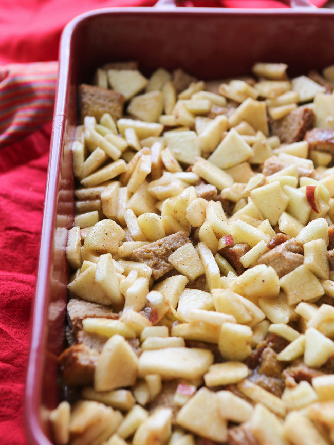 bread and diced apples in a casserole dish