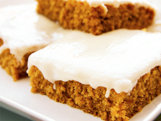 several frosted pumpkin bars up close