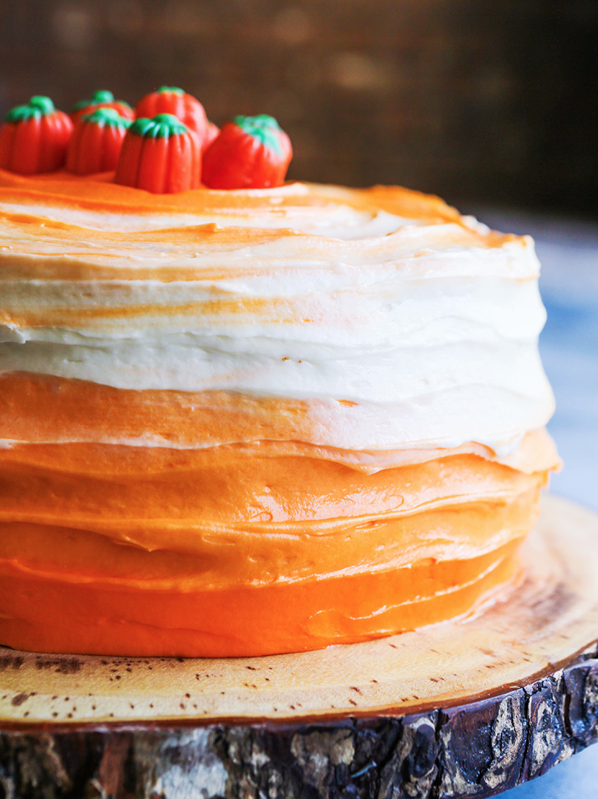 close up of the side of the ombre frosting on a pumpkin spice layer cake