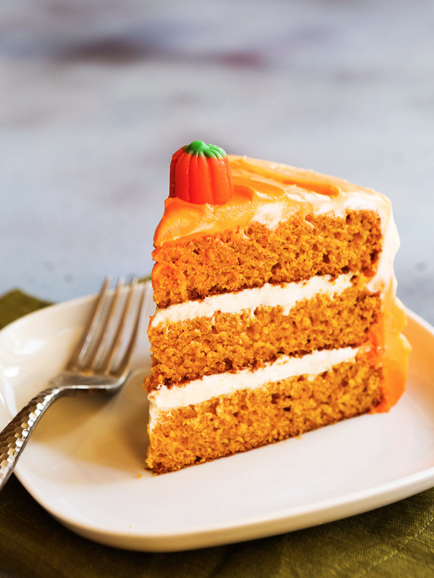 Slice of orange cake with a fork on the plate