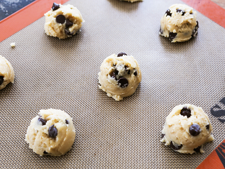 Chocolate chip cookie dough on a cookie sheet