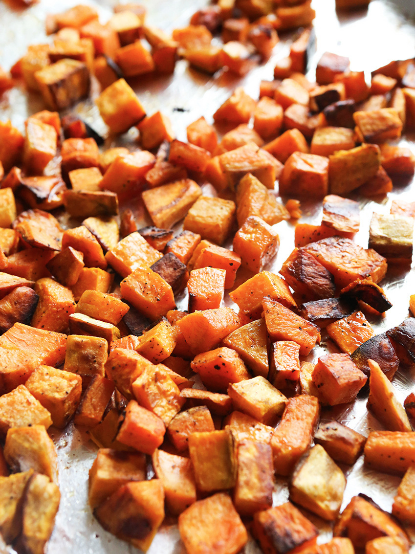 Roasted sweet potatoes spread over foil