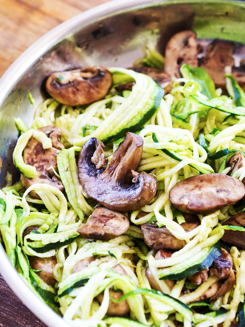 sauteed mushrooms and zoodles in a skillet