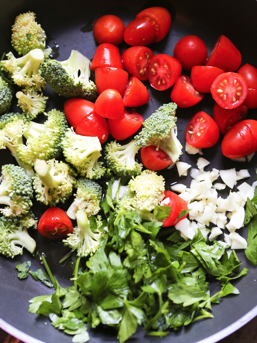 fresh broccoli, tomatoes and parsley ready to be cooked