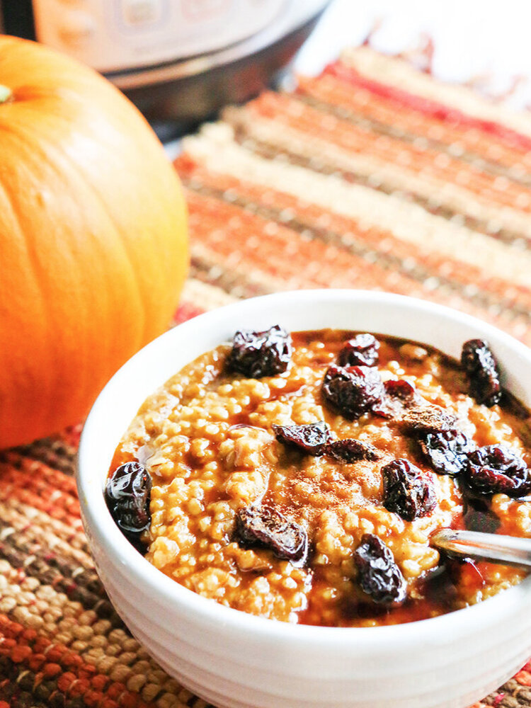 Bowl of pumpkin oatmeal with Instant Pot in background