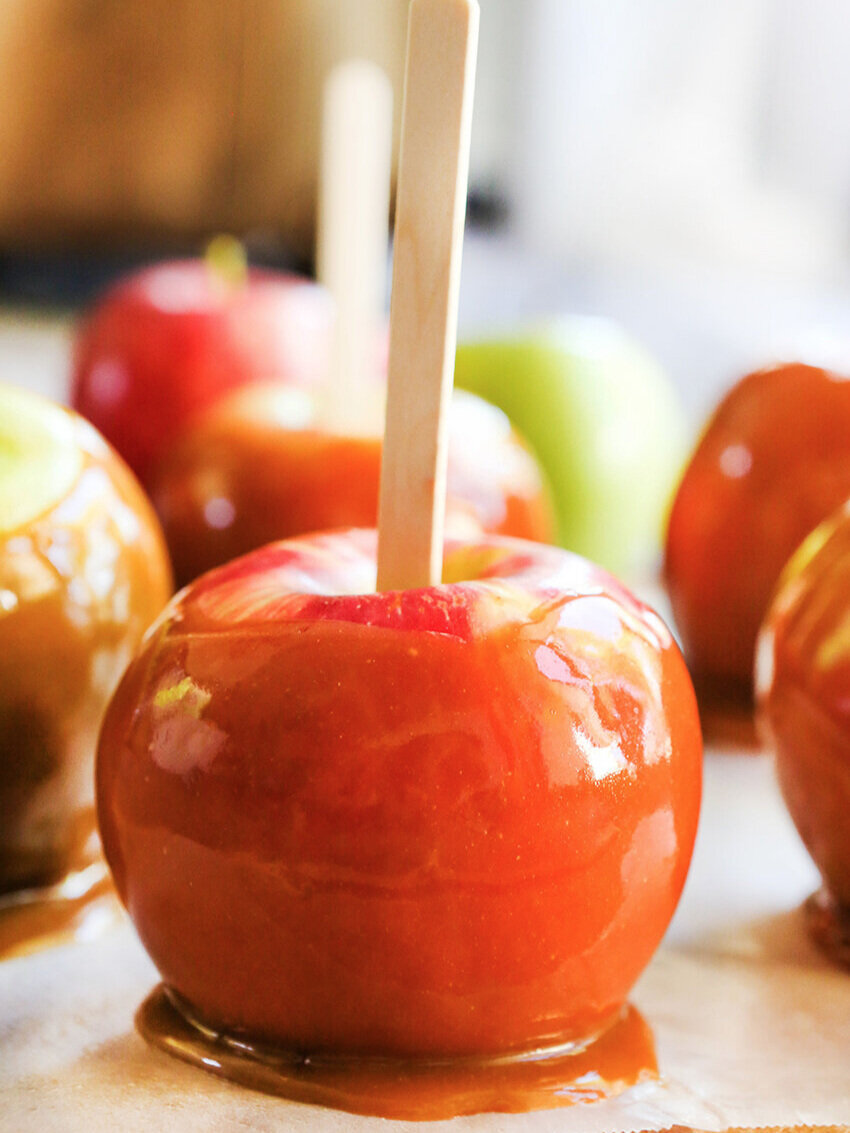 close up of a caramel apple with others in the background