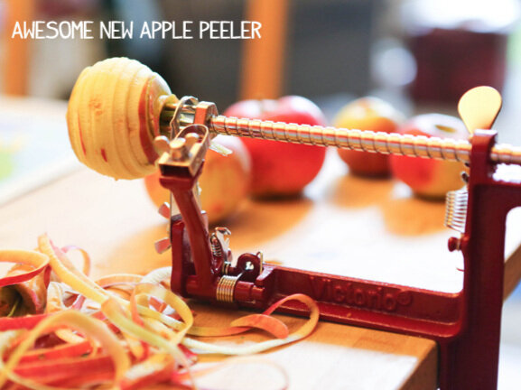 apple corer and peeler with an apple stuck in the end