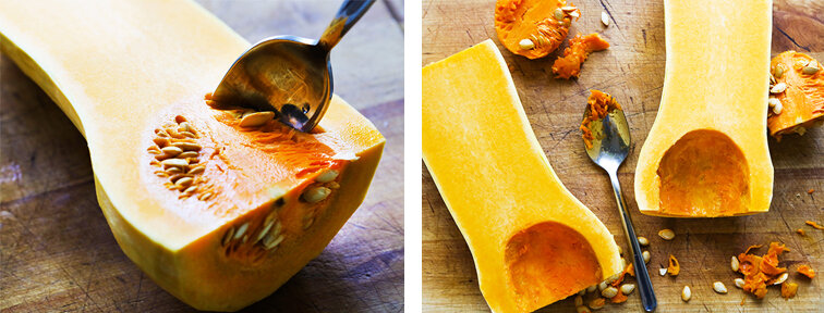 A spoon scooping seeds out of a butternut squash